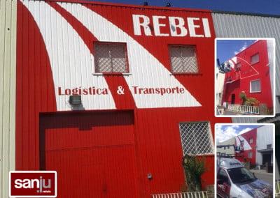Pintura de fachada y rotulación pintada en nave de Rubí